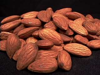 raw, unblanched, California almonds in a pile.